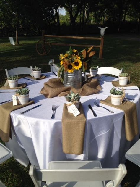 an elegant western table scape with sunflowers and burlap