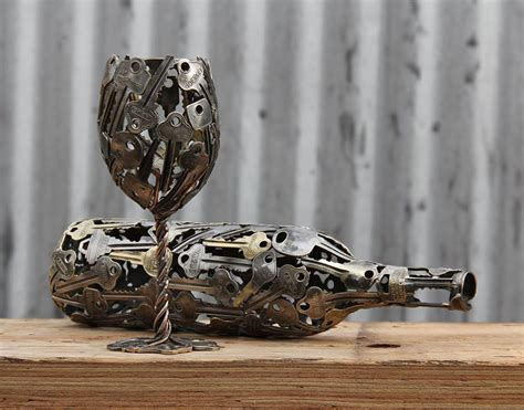 Icon Artwork by Artist Turns Old Keys And Coins Into Recycled Art Bored