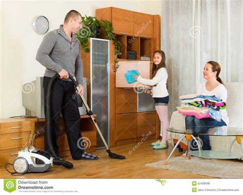 with parents cleaning at home stock photo image of