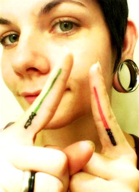 lightsaber tattoo on finger 50 awesome finger tattoos that are insanely popular