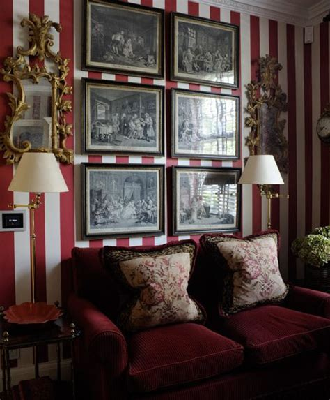 paolo moschino red and cream striped walls ls artwork gilt mirrors