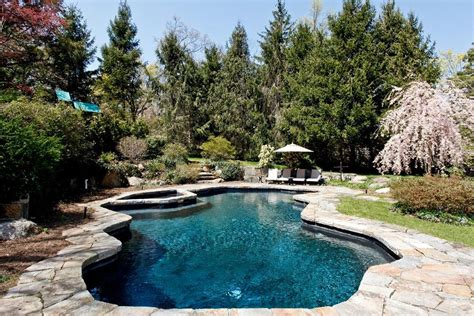 rustic swimming pool with pool with hot tub by houlihan lawrence zillow digs