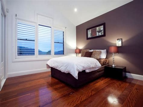 retro bedroom design idea with floorboards louvre windows using black colours bedroom photo
