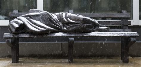 jesus on a bench sculpture of homeless jesus sleeping on bench is rejected
