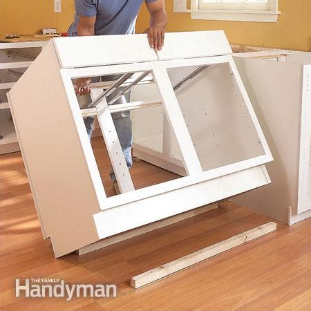 installing a kitchen island installing kitchen cabinets the family handyman