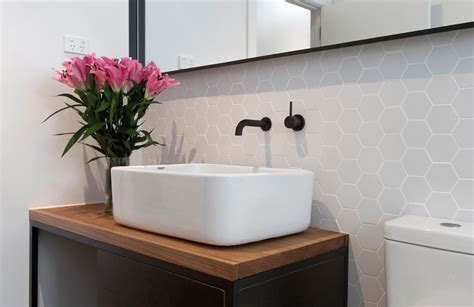 Stunning Botanical Wall Using Hexagon Tiles - beautiful hexagon tile in bathroom transitional with