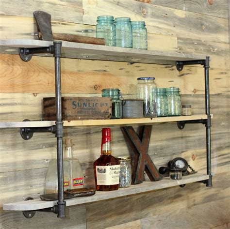 diy pipe shelf reclaimed wood plank walls