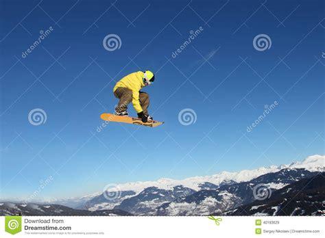 Jump Risk Yellowsun Coach snowboard jump stock photo image 40183629