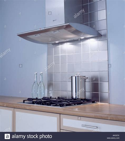 modern kitchen extractor fans stainless steel tiles below extractor fan above hob in