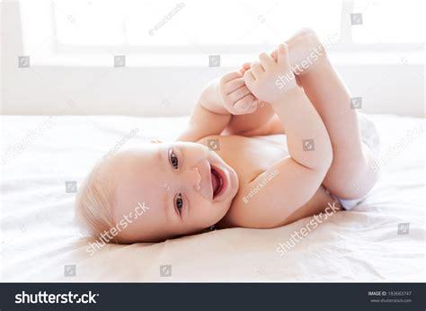 lying in my bed feeling dry happy happy little baby stock photo 183683747
