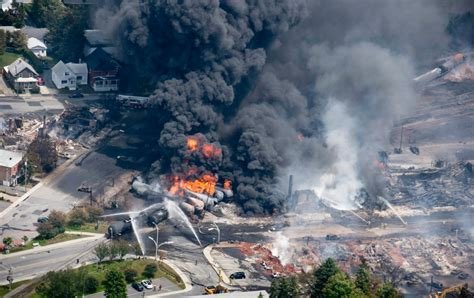 toll climbs to 13 in lac megantic dozens remain