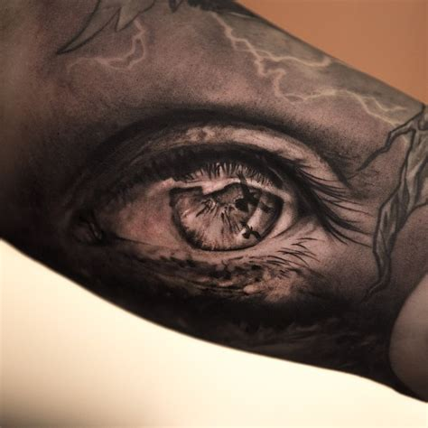 black and grey eye tattoo realistic black and grey eye tattoo on arm by niki norberg