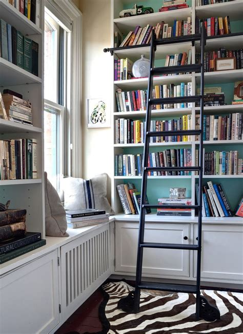 book shelves for room library with white built in shelving pop of color and a rolling ladder at home with the