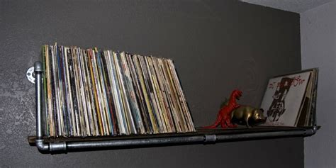 diy record shelf metal pipe and a pine board great