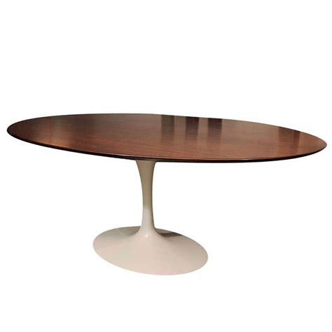 classic eero saarinen walnut topped oval dining table knoll