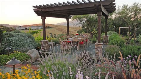 Landscape Lighting Arbor Outdoor Living Area Set In A Vineyard With A Pit
