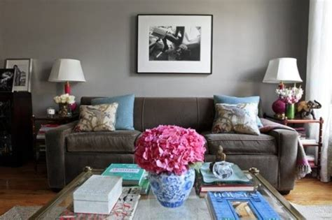 grey sofa with blue and pink room accents not the wall color will go lighter as we discussed