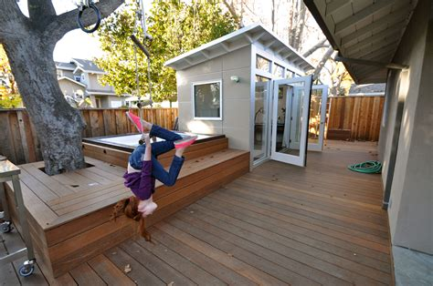 backyard guest room www studio shed com kids play both inside and around the