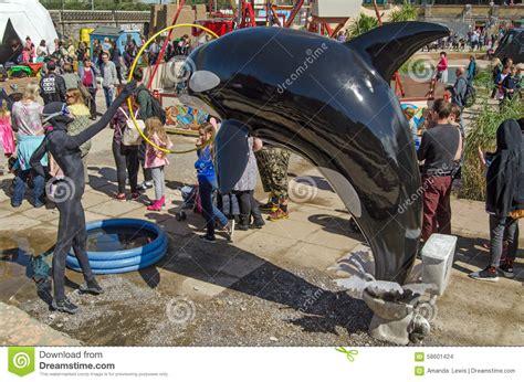 theme park queue management whale show at dismaland weston super mare editorial stock