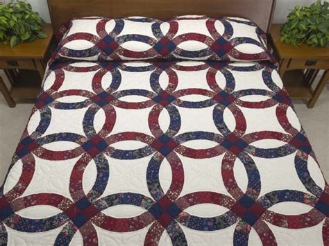 cranberry and navy blue double wedding ring quilt