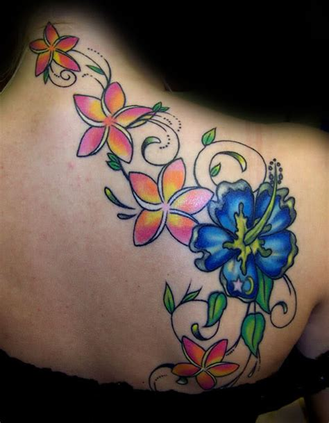 small flower tattoos on back shoulder blue and vine flower tattoos on back shoulder