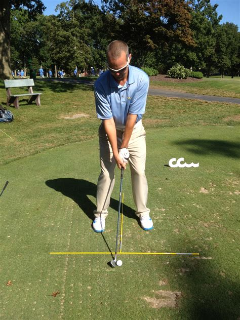 sweeping golf swing set up and ball position