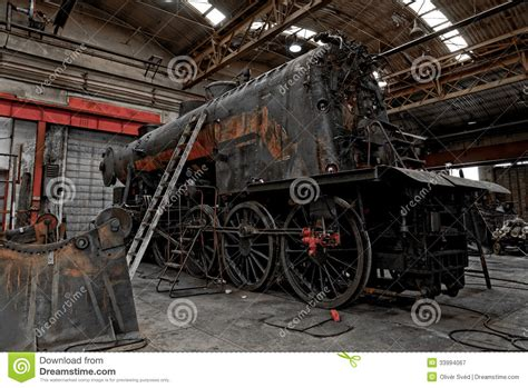 Garage With Workshop Plans Old Industrial Locomotive In The Garage Royalty Free Stock