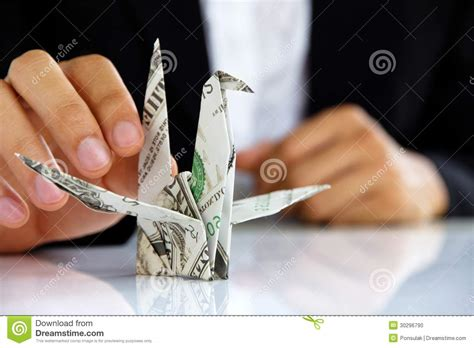 Origami Holding - business holding origami paper cranes stock photo