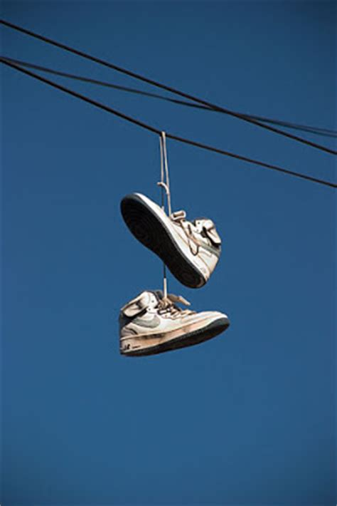 hanging photos on wire well awake what does shoes hanging on a telephone wire