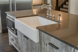 gray barn wood kitchen island with farm sink cottage