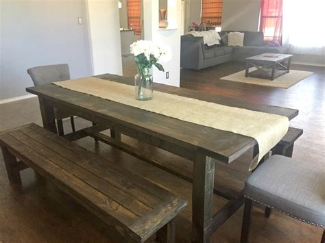 white farmhouse dining room table with benches