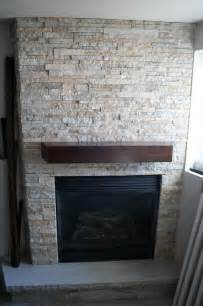 stacked fireplace modern basement by the