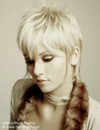 hairstyles to hide sideburns women pixie cut with an elongated nape and sideburn tendrils by