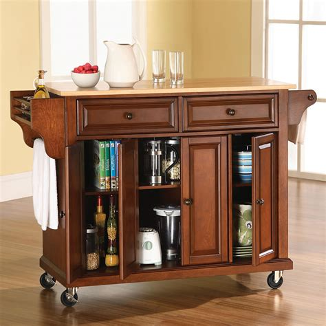 rolling island kitchen the rolling organized kitchen island hammacher schlemmer