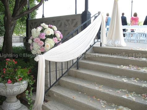 outdoor wedding draping simple draping transformed this railing for an outdoor
