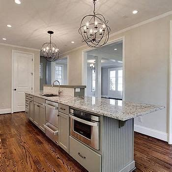 long kitchen islands transitional kitchen murphy long gray beadboard kitchen island with stacked dishwasher