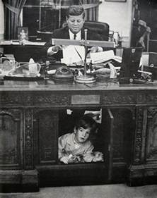 Jfk Oval Office by John F Kennedy Jr Playing In The Resolute Desk