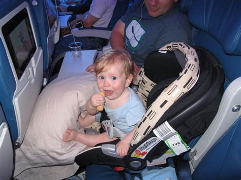 10 Tips For Flying With Baby Or Flights Travel Tips For Flying With A Baby Tips For Baby Travel