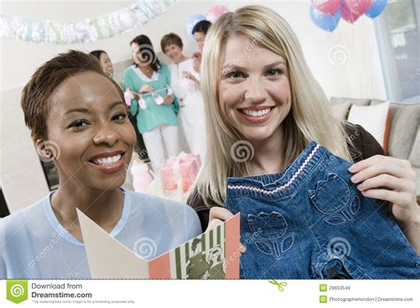 Holding A Baby Shower by Happy Friends Holding Baby Shower Gifts Stock Image