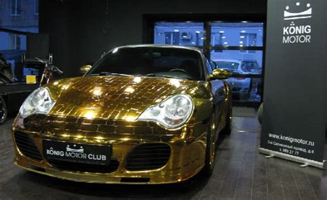 trump gold plated car gold porsche 911 redefines gaudy in russian showroom
