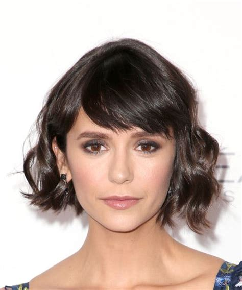 front view of side swept hairstyles nina dobrev short wavy casual bob hairstyle with side