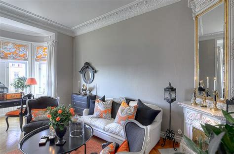 Orange And Grey Living Room by Grey And Orange Living Room Yellow Orange