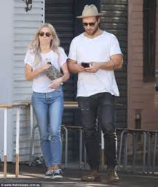 jai courtney s girlfriend mecki dent flashes her bra
