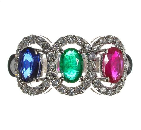 18ct white gold sapphire emerald ruby and cluster ring