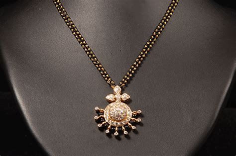 Indian Jewellery and Clothing: Simple and cute diamond Mangalsutra designs from Vasundhara