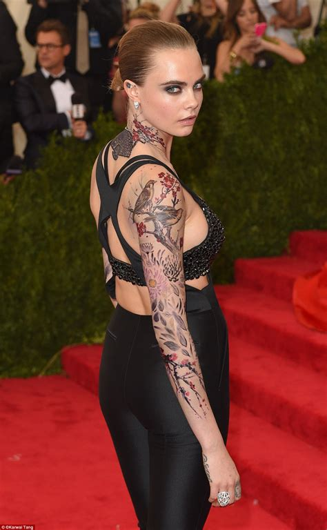 cara delevingne turns heads at met gala 2015 daily mail
