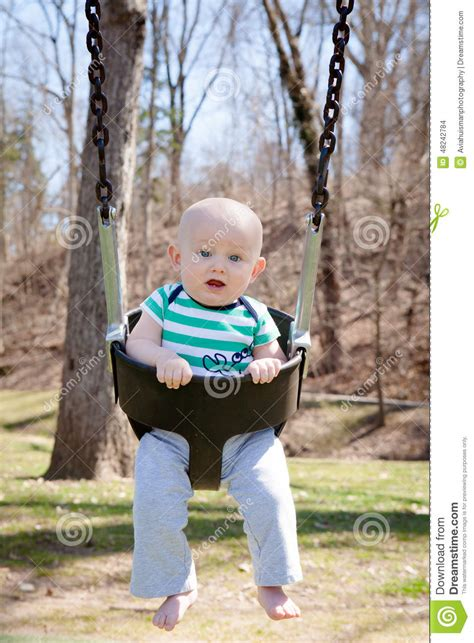 baby on a swing swinging baby stock photo image 48242784