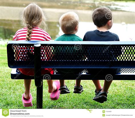 kid on bench kids on bench stock image image 1154491