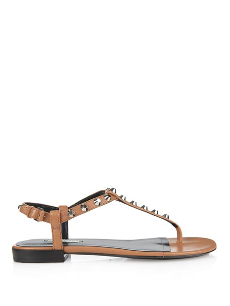 balenciaga arena studded flat sandals in brown lyst