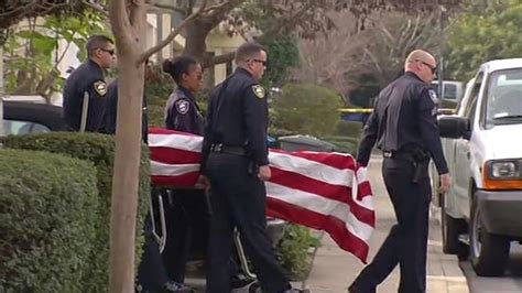 solemn procession follows slain richmond officer to